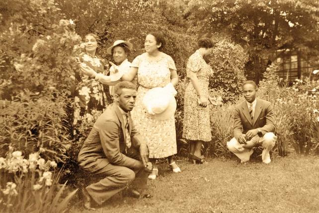 Anne & Edward Spencer with friends in the garden.